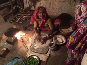 "This woman is making ""roti"", a flat bread made from a traditional stoneground wholemeal flour known as ""atta""."