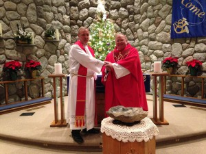 "Pastor Roger Bauer (right) ""brings it on home"" at his installation at Hope in Rhodes. Assistant to the Bishop, Pastor David Sprang, represented the synod."
