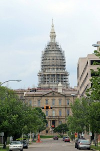 Michigan's capitol building under scaffolding reminded assembly-goers that undergoing change can be inconvenient – but is necessary. – photo by Bob Frei