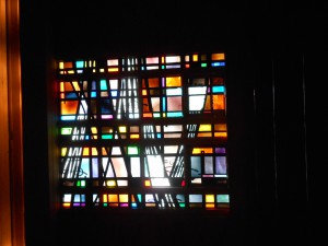 This many-colored window is behind the choir loft where the kids were seated. It reminded me that when the Spirit shines through God's people of all colors, transformation happens.