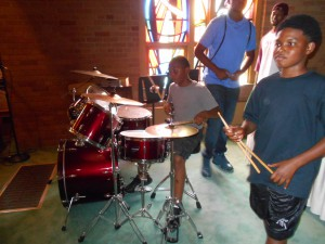Three young men kept things moving along on the drums.