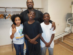 """Pastor Kareem Bowen with three day campers from The Potter's Touch. C.J., right, liked arts and crafts the best: """"I like the art part… I like to create."""""""