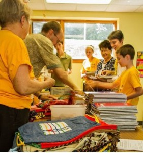 Volunteers assembled 110 school kits