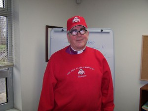 U of M fan Bishop Satterlee sports OSU's scarlet and gray.