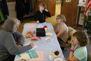 Makayla Wiseman, second from right, talks with Sue Sprang (left) about the bake sale. Also in the picture are her sister, Sarah (right), and their friend, Shannon Graham.