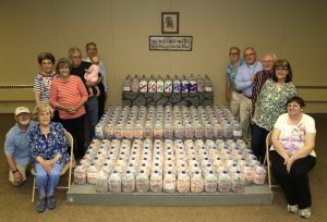 Immanuel members flank the one million pennies.
