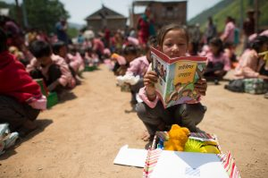 Children in Nepal dig into their shoeboxes to find treasures, hope, and lots of love