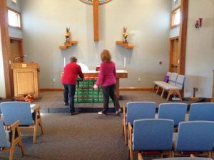 The 100+ boxes were placed at the altar to be included in the Prayers of the Church.